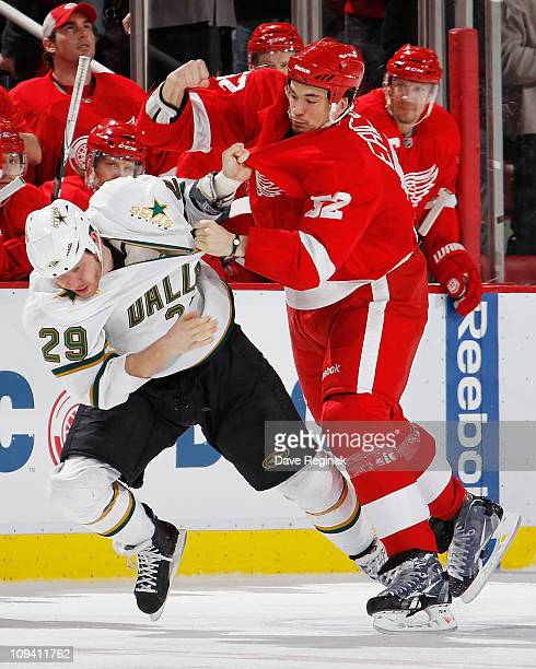 Jonathan Ericsson of the Detroit Red Wings takes swing at Steve Ott of the Dallas Stars during an NHL game at Joe Louis Arena on February 24 2011 in...