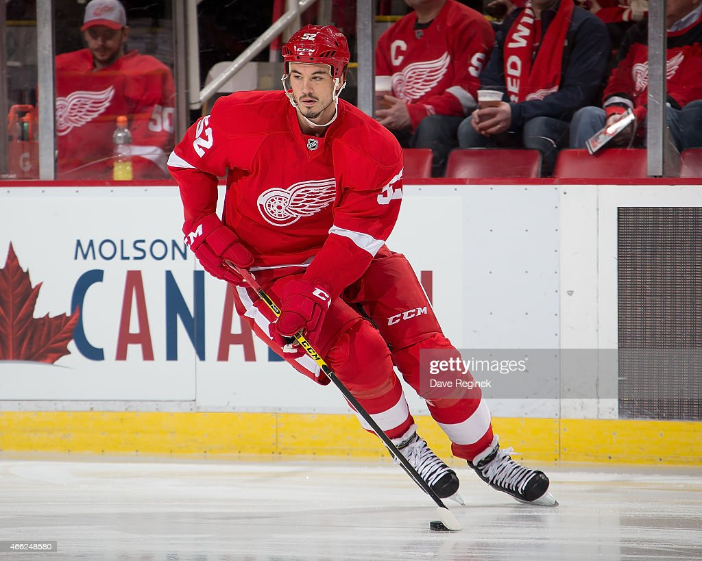 Jonathan Ericsson of the Detroit Red Wings turns up ice with the puck during a NHL game against the Calgary Flames on March 6 2015 at Joe Louis Arena...