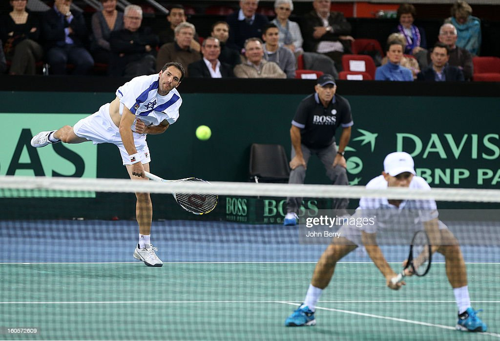 Jonathan Erlich (L) and Dudi Sela of Israel in action during their doubles match against Julien Bennetteau and Michael Llodra of France on day two of the Davis Cup first round match between France and Israel at the Kindarena stadium on February 2, 2013 in Rouen, France.
