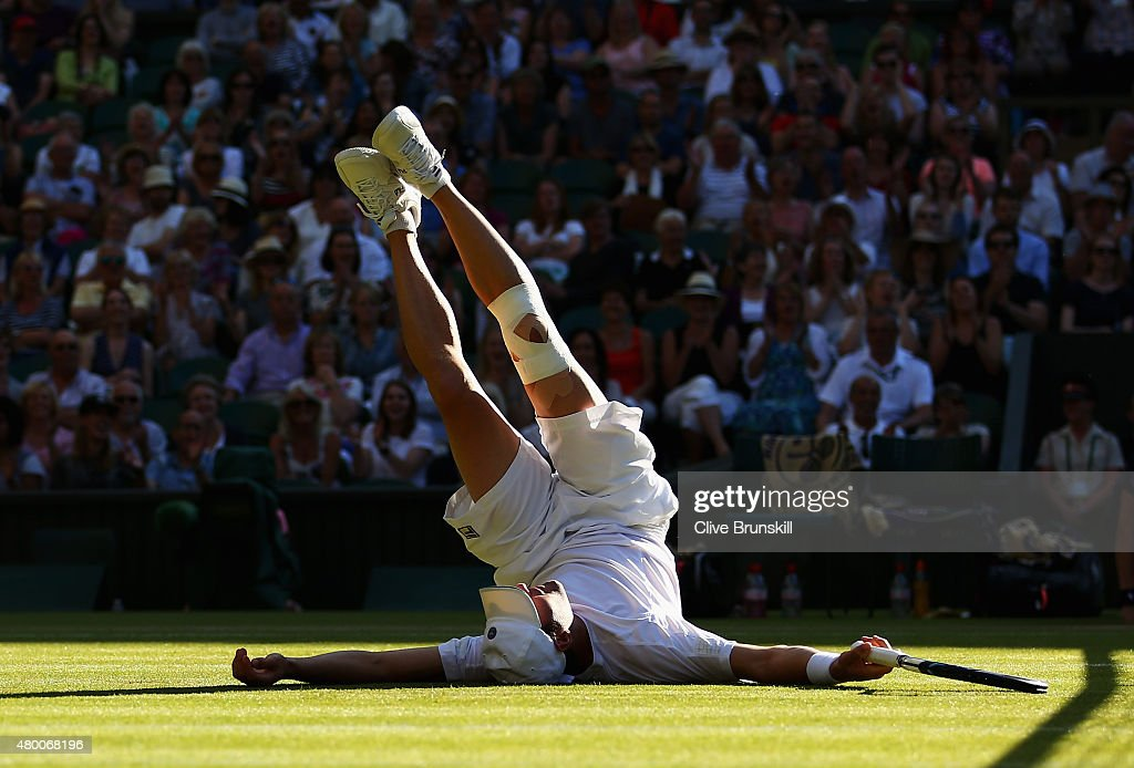 Jonathan Erlich of Israel falls at the net playing with partner Philipp Petzschner of Germany in the Gentlemens Doubles Semi Final match against John Peers of Australia playing with partner Jamie Murray of Great Britain during day ten of the Wimbledon Lawn Tennis Championships at the All England Lawn Tennis and Croquet Club on July 9, 2015 in London, England.