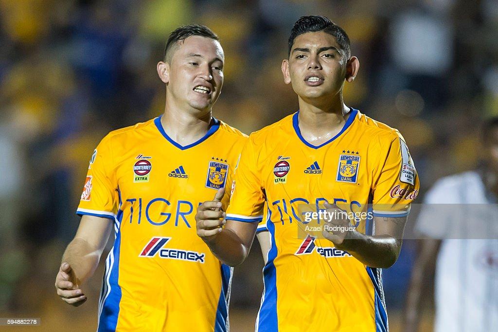 Jonathan Espericueta of Tigres celebrates with teammate Fernando Fernandez after scoring his team's first goal through a penalty kick during the...