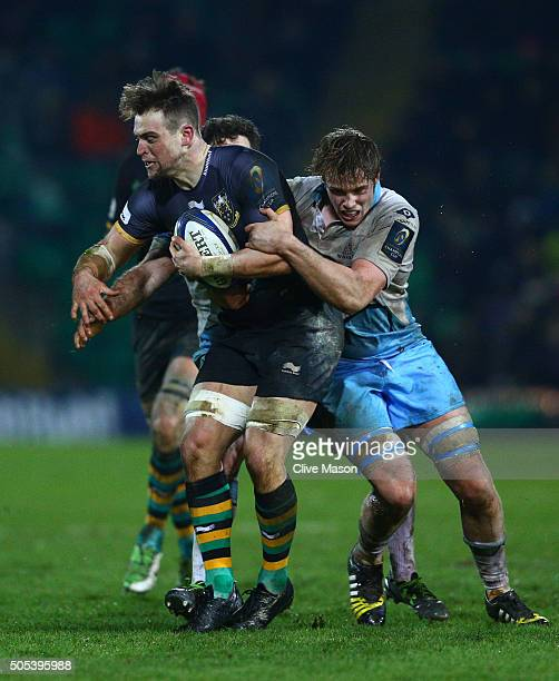 Jonathan Fisher of Northampton Saints is tackled by Alex Dunbar and Jonny Gray of Glasgow Warriors during the European Rugby Champions Cup pool three...