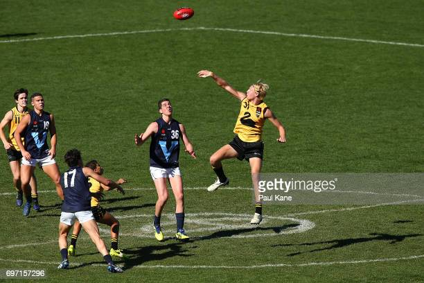 Jonathan Frampton of Western Australia wins a ruck contest against Tristan Xerri of Vic Metro during the U18 Championships match between Western...
