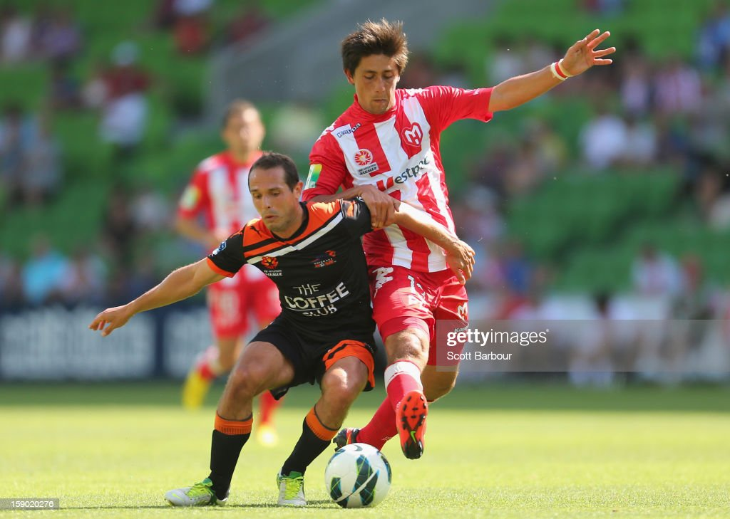Jonathan Germano of the Heart and Massimo Murdocca of the Roar compete for the ball during the round 15 A-League match between the Melbourne Heart and the Brisbane Roar at AAMI Park on January 6, 2013 in Melbourne, Australia.