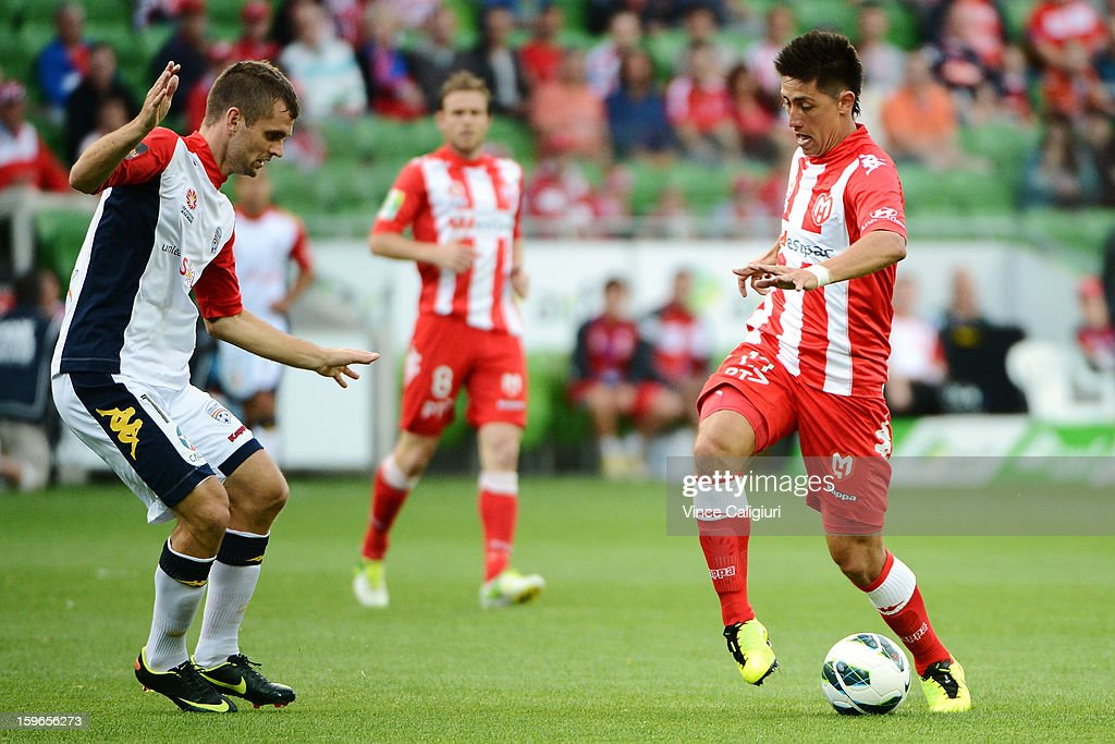 Jonathan Germano of the Heart contests the ball with Cameron Watson of United during the round seventeen A-League match between Melbourne Heart and Adelaide United at AAMI Park on January 18, 2013 in Melbourne, Australia.
