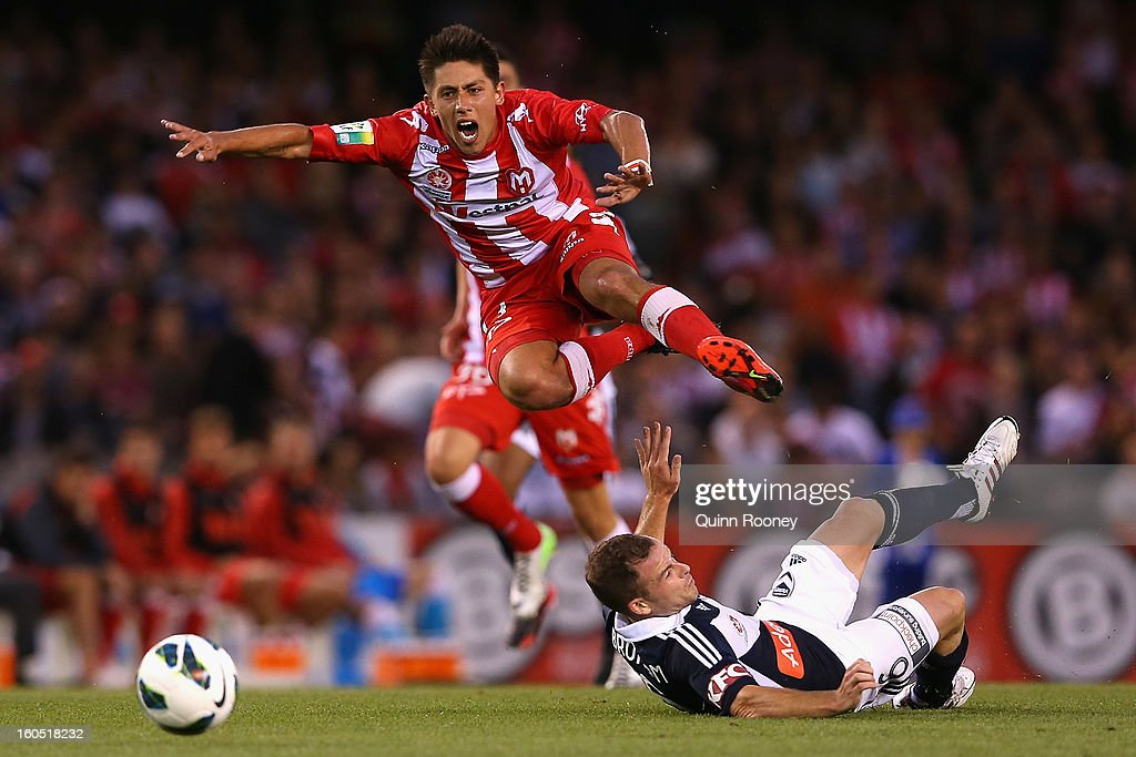 Jonathan Germano of the Heart is tackled by <a gi-track='captionPersonalityLinkClicked' href=/galleries/search?phrase=Leigh+Broxham&family=editorial&specificpeople=4103215 ng-click='$event.stopPropagation()'>Leigh Broxham</a> of the Victory during the round 19 A-League match between the Melbourne Victory and the Melbourne Heart at Etihad Stadium on February 2, 2013 in Melbourne, Australia.