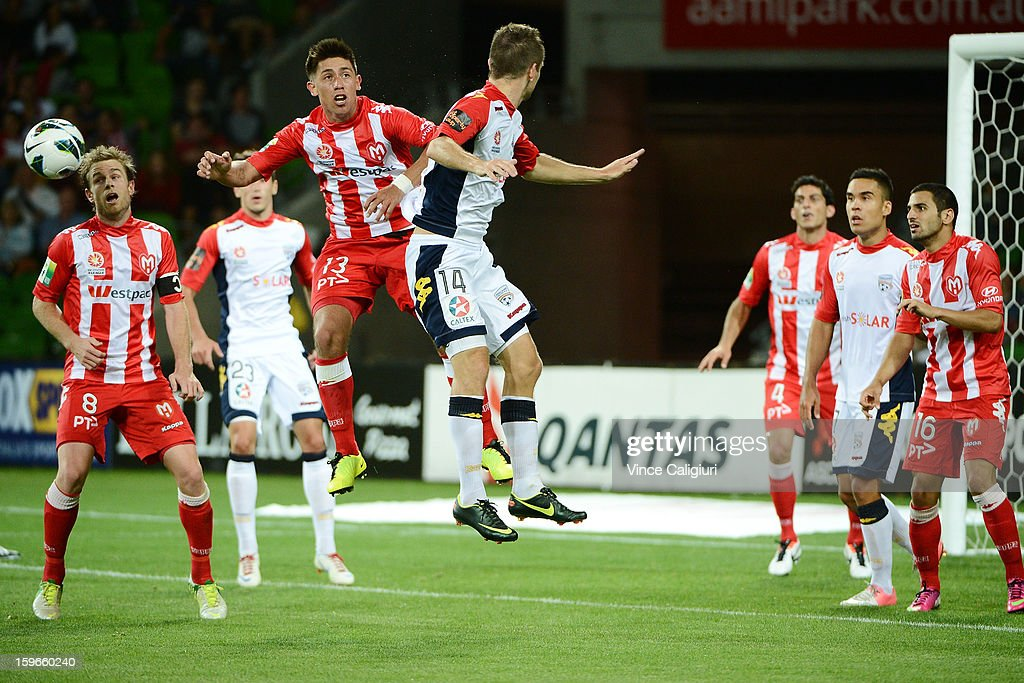 Jonathan Germano of the Heart jumps for a header with Cameron Watson of United during the round seventeen A-League match between Melbourne Heart and Adelaide United at AAMI Park on January 18, 2013 in Melbourne, Australia.
