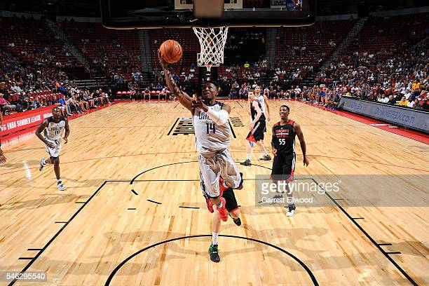 Jonathan Gibson of Dallas Mavericks goes for the lay up during the game against the Toronto Raptors during the 2016 Las Vegas Summer League on July...