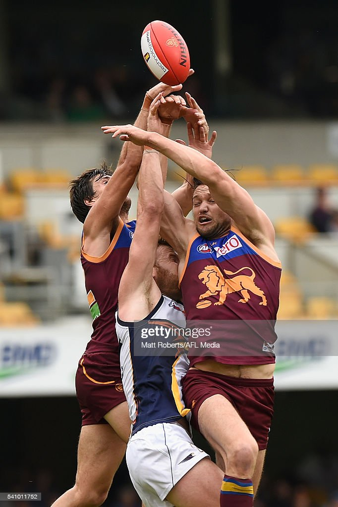 Jonathan Giles of the Eagles competes for the ball against Sam Mayes and Stefan Martin of the Lions during the round 13 AFL match between the Brisbane Lions and the West Coast Eagles at The Gabba on June 18, 2016 in Brisbane, Australia.