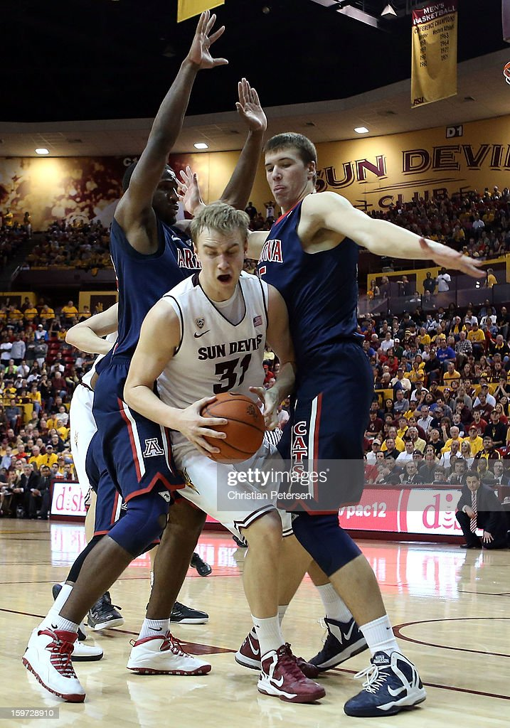 Jonathan Gilling #31 of the Arizona State Sun Devils is defended by Solomon Hill #44 and <a gi-track='captionPersonalityLinkClicked' href=/galleries/search?phrase=Kaleb+Tarczewski&family=editorial&specificpeople=8047518 ng-click='$event.stopPropagation()'>Kaleb Tarczewski</a> #35 of the Arizona Wildcats during the college basketball game at Wells Fargo Arena on January 19, 2013 in Tempe, Arizona. The Wildcats defeated the Sun Devils 71-54.