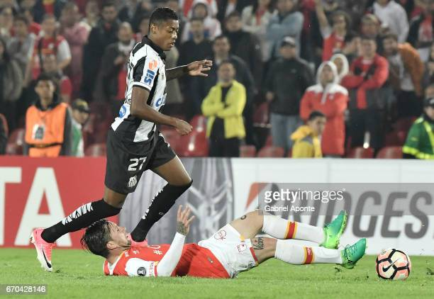Jonathan Gomez of Santa Fe struggles for the ball with Bruno Henrique of Santos during a group stage match between Independiente Santa Fe v Santos as...