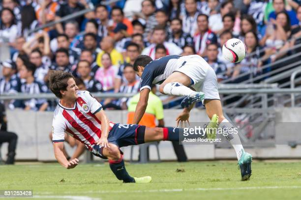 Jonathan Gonzalez of Monterrey fights for the ball with Carlos Fierro of Chivas during the 4th round match between Monterrey and Chivas as part of...
