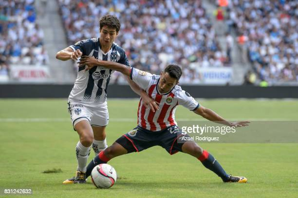 Jonathan Gonzalez of Monterrey fights for the ball with Jose Vazquez of Chivas during the 4th round match between Monterrey and Chivas as part of the...