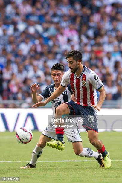 Jonathan Gonzalez of Monterrey fights for the ball with Rodolfo Pizarro of Chivas during the 4th round match between Monterrey and Chivas as part of...