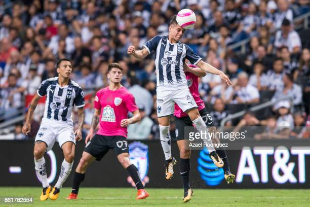 Jonathan Gonzalez of Monterrey heads the ball with Victor Guzman of Pachuca during the 13th round match between Monterrey and Pachuca as part of the...