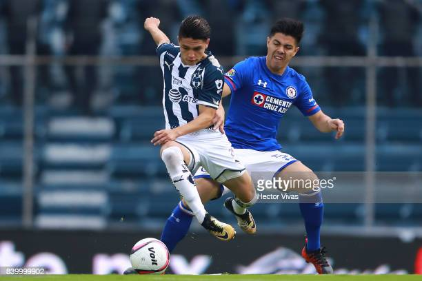 Jonathan Gonzalez of Monterrey struggles for the ball with Francisco Silva of Cruz Azul during the seventh round match between Cruz Azul and...