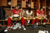 Jonathan Goodwin Mike Iupati and Joe Staley of the San Francisco 49ers relax in the locker room prior to Super Bowl XLVII against the Baltimore...