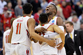 Jonathan Graham and Varun Ram of the Maryland Terrapins react after defeating the Valparaiso Crusaders during the second round of the Men's NCAA...