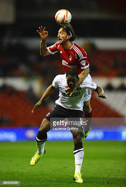 Jonathan Greening of Nottingham Forest battles with Marvin Sordell of Charlton Athletic during the Sky bet Championship match between Nottingham...