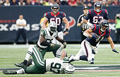 Jonathan Grimes of the Houston Texans is tackled by Calvin Pace of the New York Jets in the second half on November 22 2015 at NRG Stadium in Houston...