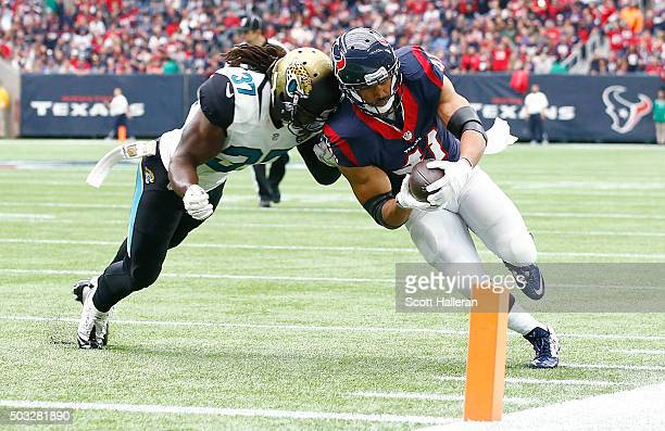 Jonathan Grimes of the Houston Texans scores a touchdown on a 12 yard reception against the Johnathan Cyprien of the Jacksonville Jaguars in the...