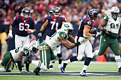 Jonathan Grimes of the Houston Texans tries to break the tackle of Calvin Pace of the New York Jets at NRG Stadium on November 22 2015 in Houston...
