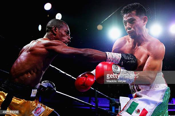 Jonathan Guzman throws a right at Danny Aquino during their Super Bantamweight bout on October 10 2015 at Lowell Memorial Auditorium in Lowell...