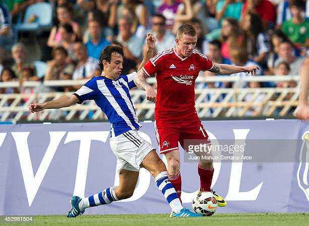 Jonathan Hayes of Aberdeen CF duels for the ball with Ruben Pardo of Real Sociedad during the UEFA Europa League third round qualifying first leg...