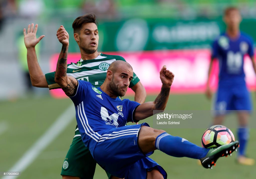 Jonathan Heris (R) of Puskas Akademia FC wins the ball from Lukacs Bole (L) of Ferencvarosi TC during the Hungarian OTP Bank Liga match between Ferencvarosi TC and Puskas Akademia FC at Groupama Arena on July 16, 2017 in Budapest, Hungary.