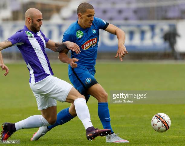 Jonathan Heris of Ujpest FC competes for the ball with Myke Bouard Ramos of MTK Budapest during the Hungarian OTP Bank Liga match between Ujpest FC...