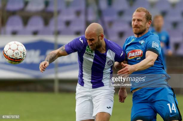 Jonathan Heris of Ujpest FC competes for the ball with Sandor Torghelle of MTK Budapest during the Hungarian OTP Bank Liga match between Ujpest FC...