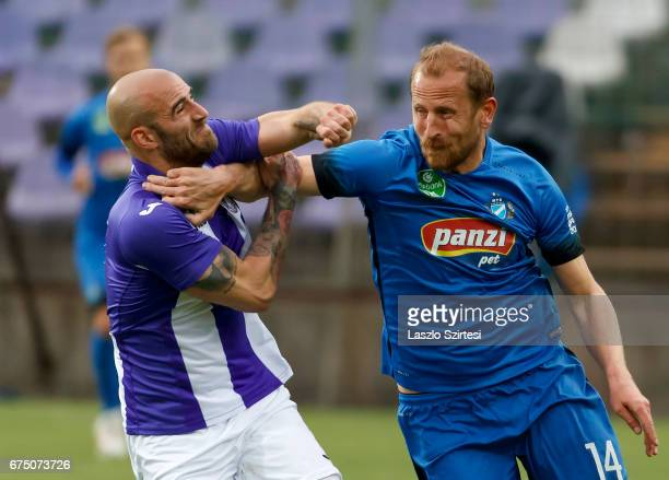 Jonathan Heris of Ujpest FC fights with Sandor Torghelle of MTK Budapest during the Hungarian OTP Bank Liga match between Ujpest FC and MTK Budapest...