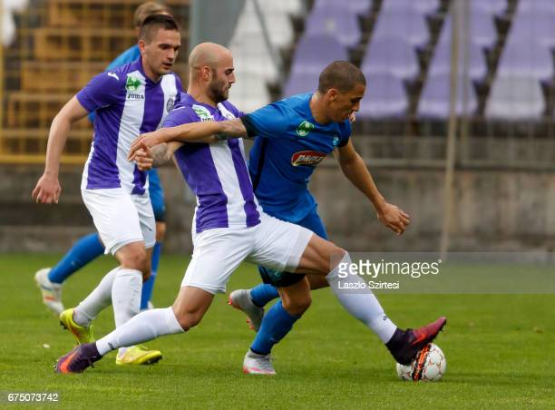 Jonathan Heris of Ujpest FC tackles Myke Bouard Ramos of MTK Budapest before Kristof Szucs of Ujpest FC during the Hungarian OTP Bank Liga match...