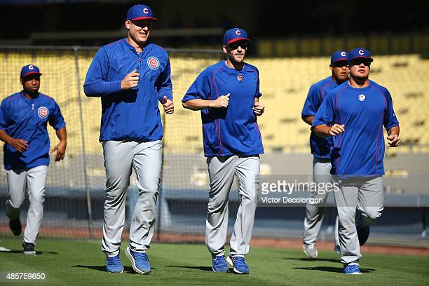 Jonathan Herrera Anthony Rizzo Chris Denorfia Addison Russell and Kyle Schwarber of the Chicago Cubs jog prior to batting practice prior to their MLB...