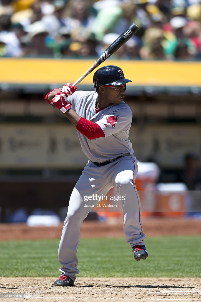 Jonathan Herrera of the Boston Red Sox at bat against the Oakland Athletics during the third inning at Oco Coliseum on June 22 2014 in Oakland...