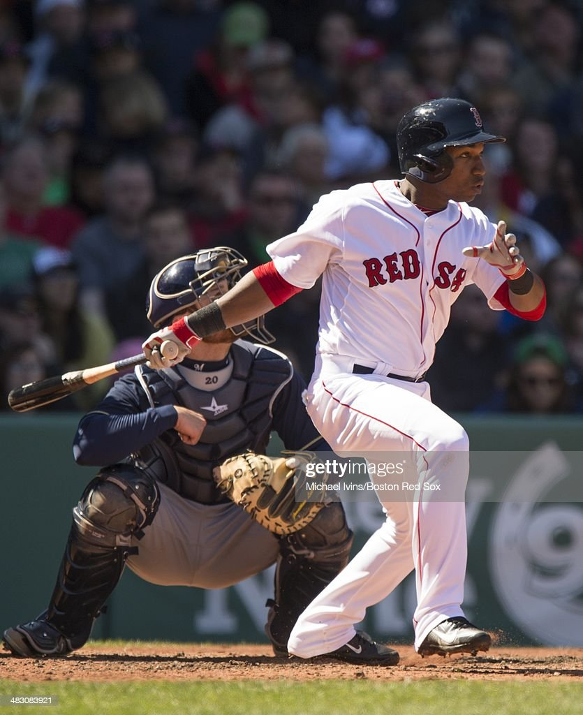 Jonathan Herrera of the Boston Red Sox hits a single against the Milwaukee Brewers in the third inning at Fenway Park on April 6 3014 in Boston...