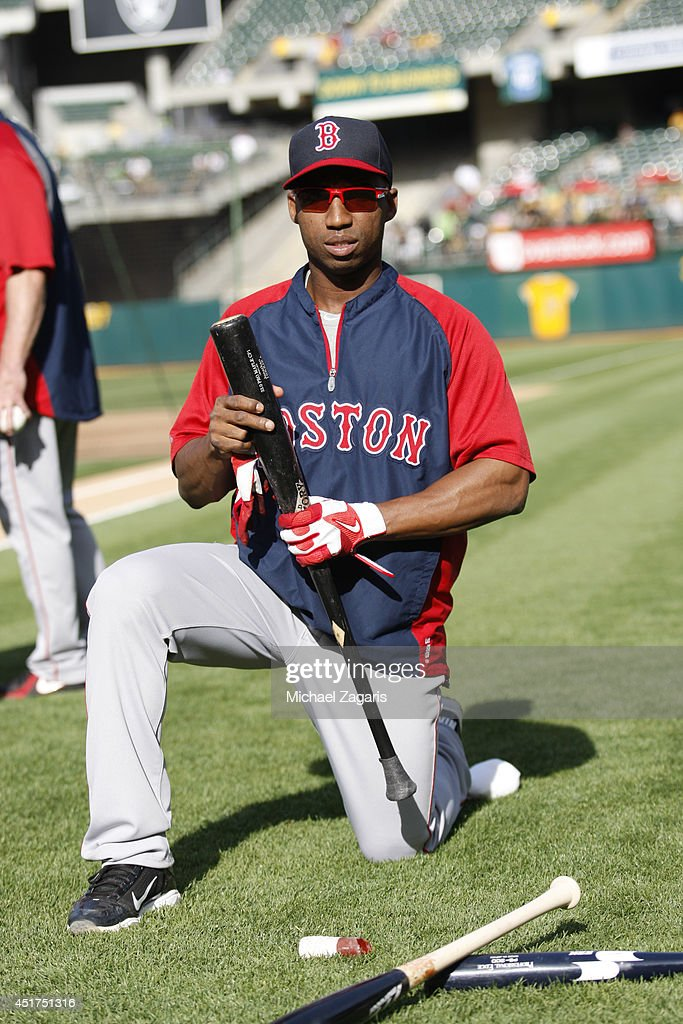 Jonathan Herrera of the Boston Red Sox kneels on the field prior to the game against the Oakland Athletics at Oco Coliseum on June 20 2014 in Oakland...