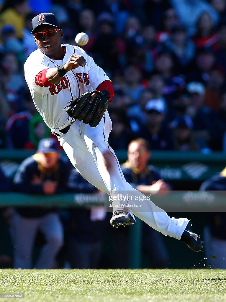 Jonathan Herrera of the Boston Red Sox throws a ground ball to first base in the 6th inning against the Milwaukee Brewers during the game at Fenway...