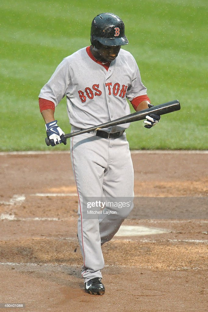 Jonathan Herrera #10 of the Boston Red Sox walks back to the dugout after striking out with bases loaded in the second inning during a baseball game against the Baltimore Orioles on June 10, 2014 at Oriole Park at Camden Yards in Baltimore, Maryland.