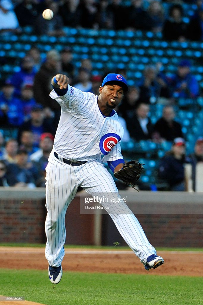 Jonathan Herrera of the Chicago Cubs makes a play on Marlon Byrd of the Cincinnati Reds on April 13 2015 at Wrigley Field in Chicago Illinois