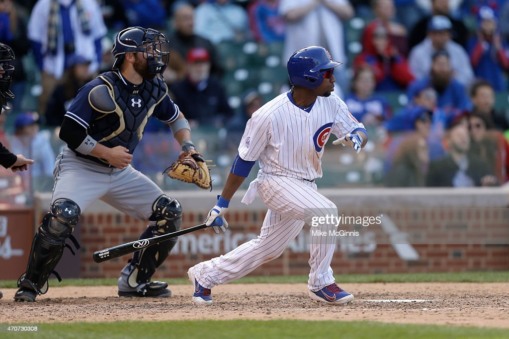 Jonathan Herrera of the Chicago Cubs makes some contact at the plate during the game against the San Diego Padres at Wrigley Field on April 18 2015...