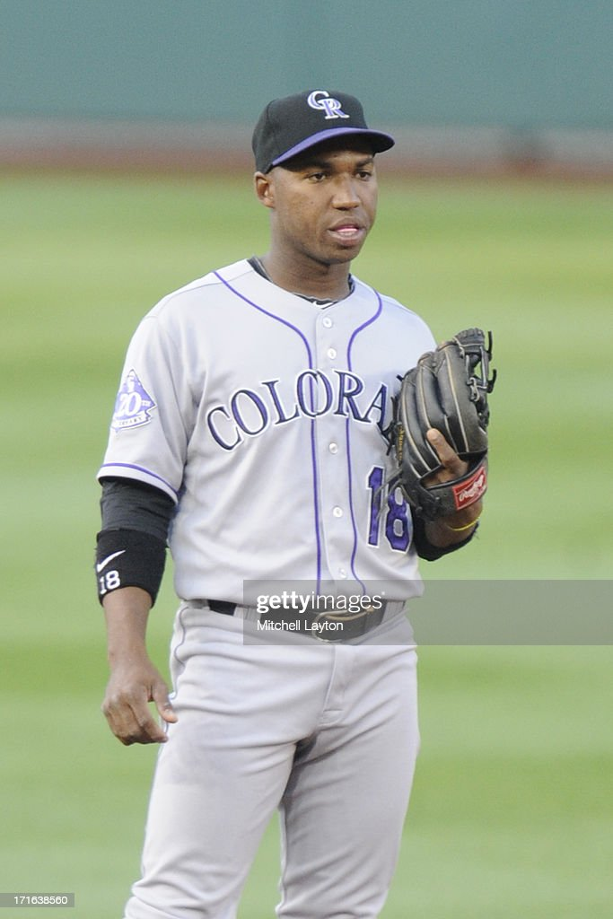 Jonathan Herrera of the Colorado Rockies looks on during the game against the Washington Nationals on June 20 2013 at Nationals Park in Washington DC...