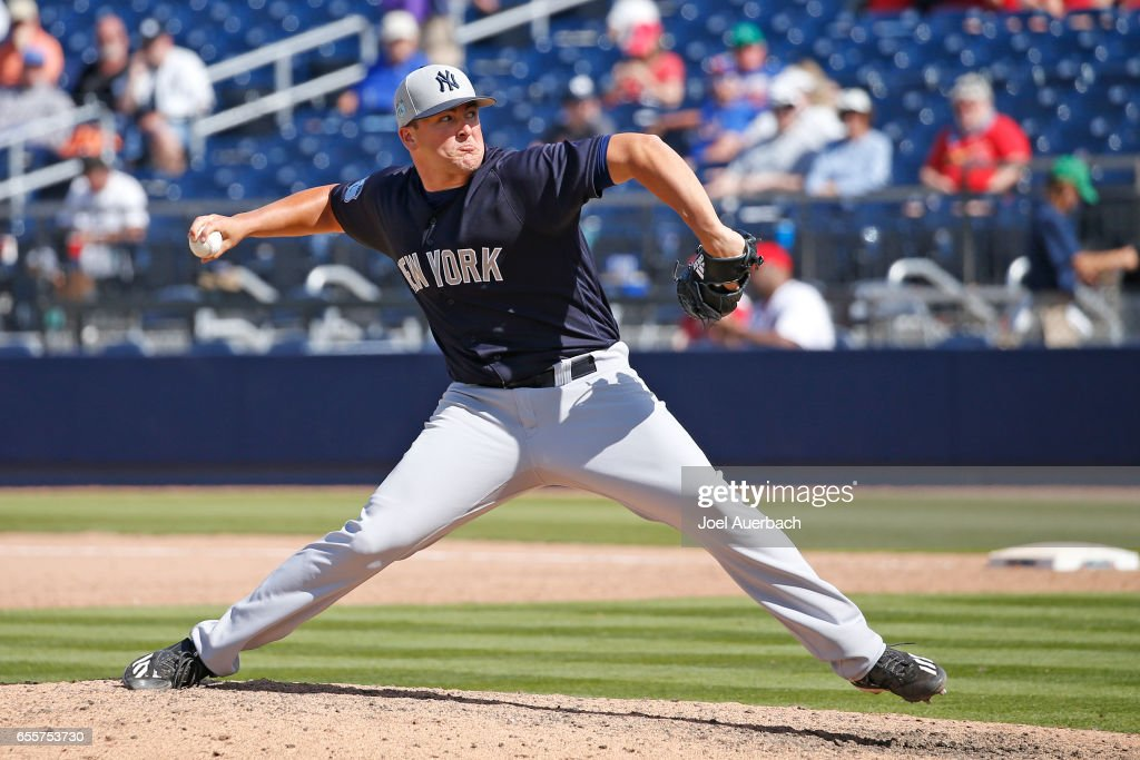 Jonathan Holder #65 of the New York Yankees throws the ball against the Washington Nationals in the eighth inning during a spring training game at The Ballpark of the Palm Beaches on March 20, 2017 in West Palm Beach, Florida. The Yankees defeated the Nationals 9-3.