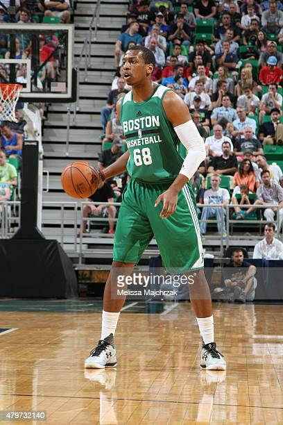 Jonathan Holmes of the Boston Celtics dribbles the ball against the Utah Jazz during the NBA Summer League on July 6 2015 at EnergySolutions Arena in...