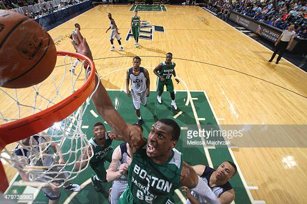 Jonathan Holmes of the Boston Celtics goes to the basket against the Utah Jazz during the NBA Summer League on July 6 2015 at EnergySolutions Arena...