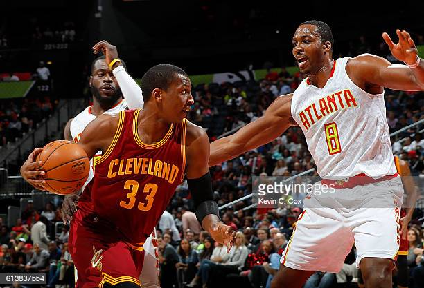 Jonathan Holmes of the Cleveland Cavaliers drives against Dwight Howard of the Atlanta Hawks at Philips Arena on October 10 2016 in Atlanta Georgia...