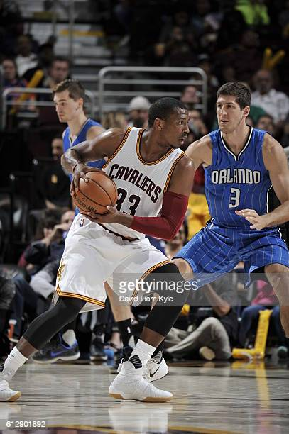 Jonathan Holmes of the Cleveland Cavaliers handles the ball against the Orlando Magic on October 5 2016 at Quicken Loans Arena in Cleveland Ohio NOTE...