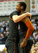 Jonathan Holmes of the Texas Longhorns celebrates after hitting a threepoint shot to defeat the Connecticut Huskies in the second half at Harry A...