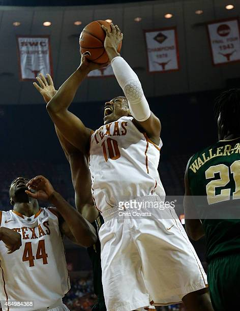 Jonathan Holmes of the Texas Longhorns goes up for a shot against the Baylor Bears at the Frank Erwin Center on March 2 2015 in Austin Texas