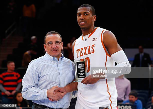 Jonathan Holmes of the Texas Longhorns poses with the MVP trophy after defeating the California Golden Bears at Madison Square Garden on November 21...